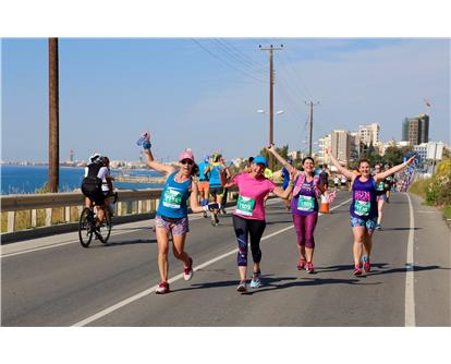 happy runners on coast Limassol